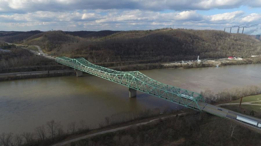 The Interstate 64 bottleneck over the Kanawha River at Nitro could be relieved in about three years. Construction is to begin soon on a new bridge next to the existing one seen here. It will be for westbound traffic. Then the existing bridge will be removed and replaced with a new bridge for eastbound traffic. (West Virginia Division of Highways photo)