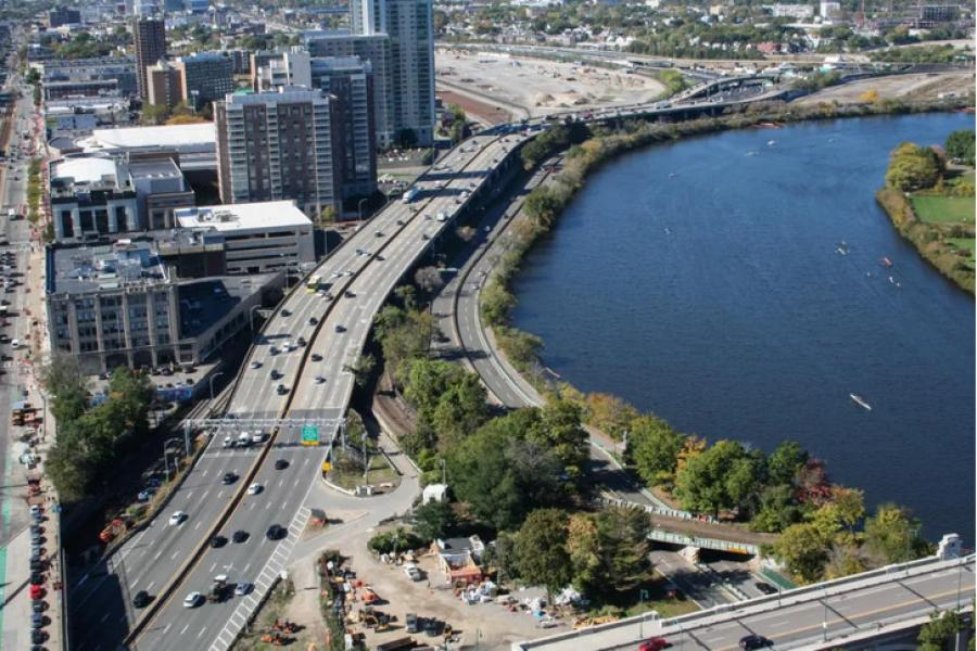 """An aerial view of the """"throat"""" section of Interstate 90 near Boston University, looking west toward the vacant former railyards where Harvard University aims to develop a new urban neighborhood of housing, office and lab space. (MassDOT photo)"""