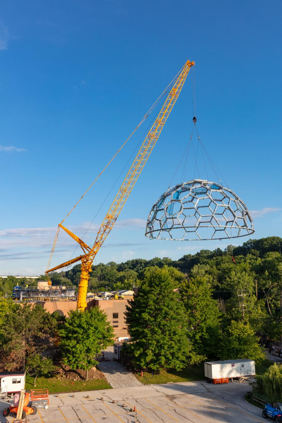 The new direction called for assembling the full dome structure on the ground, instead of in the air. Finished, the new, pre-fab metal dome is 36 ft. tall and 73 ft. in diameter. It weighs 77,000 lbs.