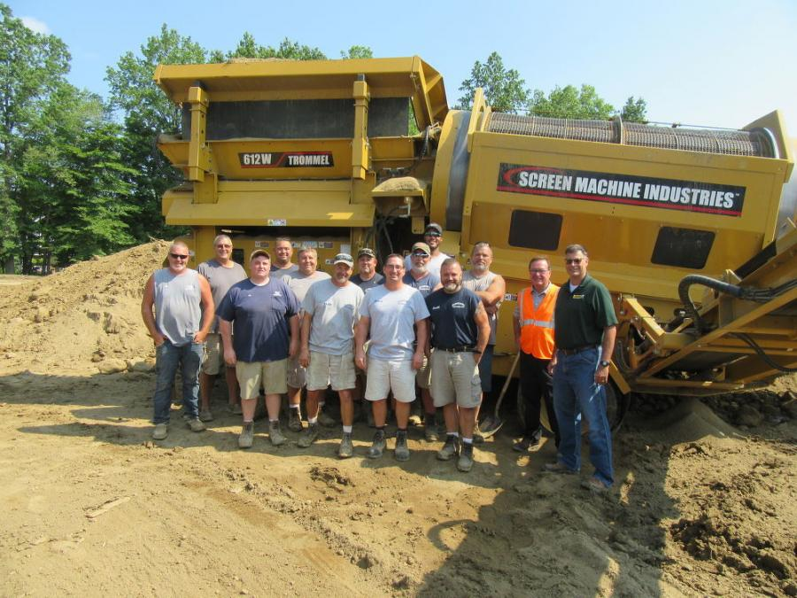 The Alliance Water and Sewer Distribution Department crew, joined by Ohio CAT's Tom Seefried (2nd from R) and Chris Harris (R) on the work site at the city's future soccer complex.