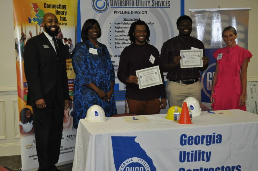 GUCA Work Ready Graduates James Ross and Francis Kwafo, received their Certificate of Completion and Safety Certifications, with Connecting Henry Staff.