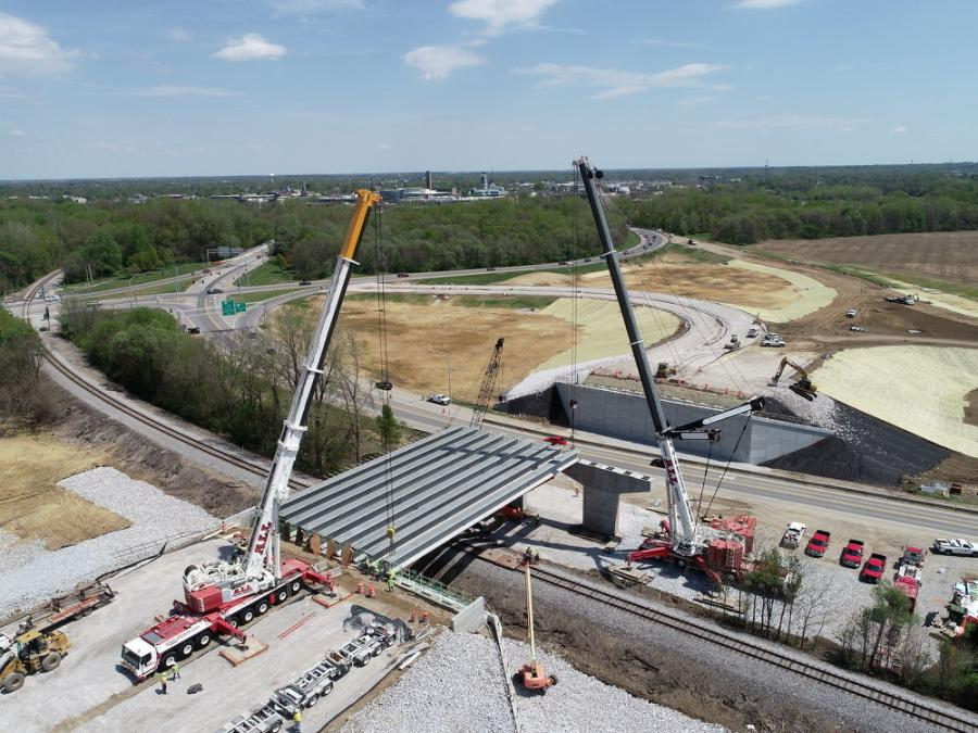 The overpass part of the project involved driving piles, setting 26 beams (13 by 2 spans) with half  the beams set over the railroad, placing concrete for the deck and barrier rails. (Milestone Contractors photo)
