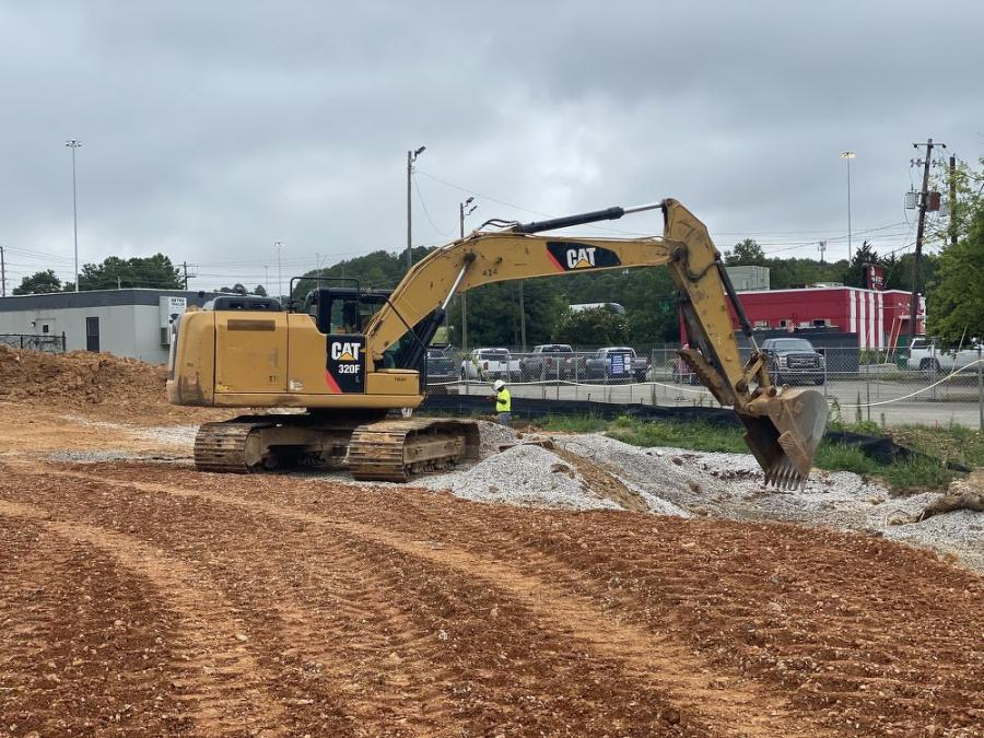 The Caterpillar 320F excavator, among other equipment, will be used for excavation, hauling, spreading and compacting the fill material. (Scott Fleming photo)