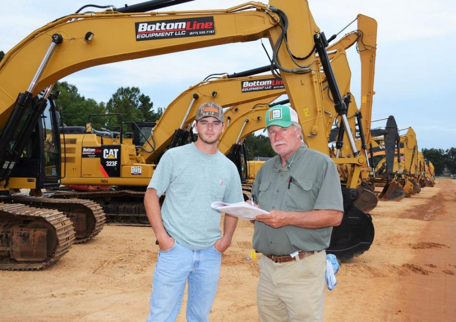 Interested in some of the excavators in the auction line-up are Dylan Wheatley (L) and Steve Wheatley of Steve Wheatley & Associates, contractors from Thomson, Ga.