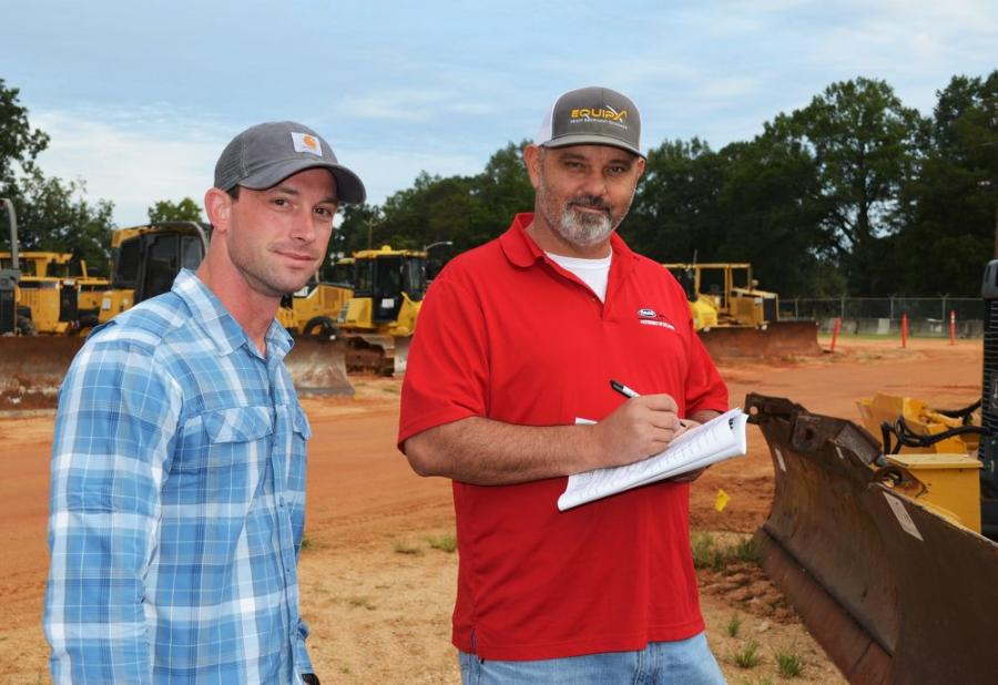 Taking notes on machines of interest are Josh Bryan (L) and Tim Thompson of EQUIPX based in Carrollton, Ga.
