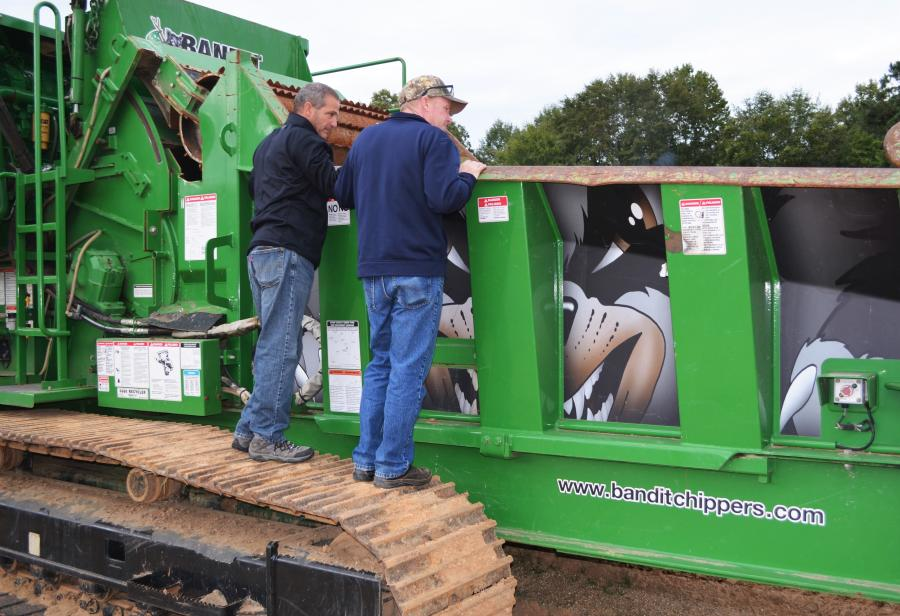 Deep in discussion on a Bandit Beast 3680 of interest are Dave Altiere (L) and Chris Altiere of CBS Topsoil Inc./Altiere's Home & Garden of Youngstown, Ohio.