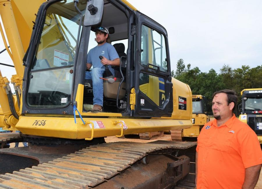 Test operating a Komatsu PC390 are Dillon Godwin (operator) and Patrick Godwin, independent contractors based in Atmore, Ala.