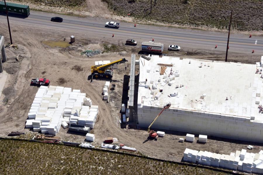 Crews from Wadsworth Brothers Construction are installing the 112,000 cu. yds. of Geofoam, supplied by Oracle and manufactured by Atlas Molded Products, using a 60-ton crane and forklifts.