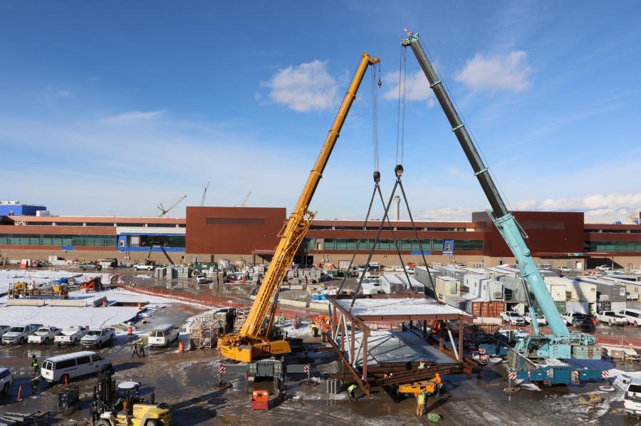 Crews perform the Gateway bridge hoist during the construction of the Salt Lake City International Airport. (Salt Lake City International Airport photo)