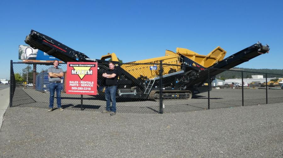 Joe Jensen (L), sales manager of Maxim Equipment (L) and Greg Evans, general manager of Maxim Equipment, are pictured in front of an IROCK mobile scalping screen at their new location in Spokane, Wash.