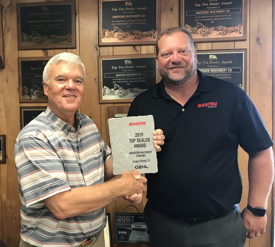 Tom Anderson, (L) owner of Anderson Machinery Company, and Chris Shoots, Manitou Group regional sales manager.
