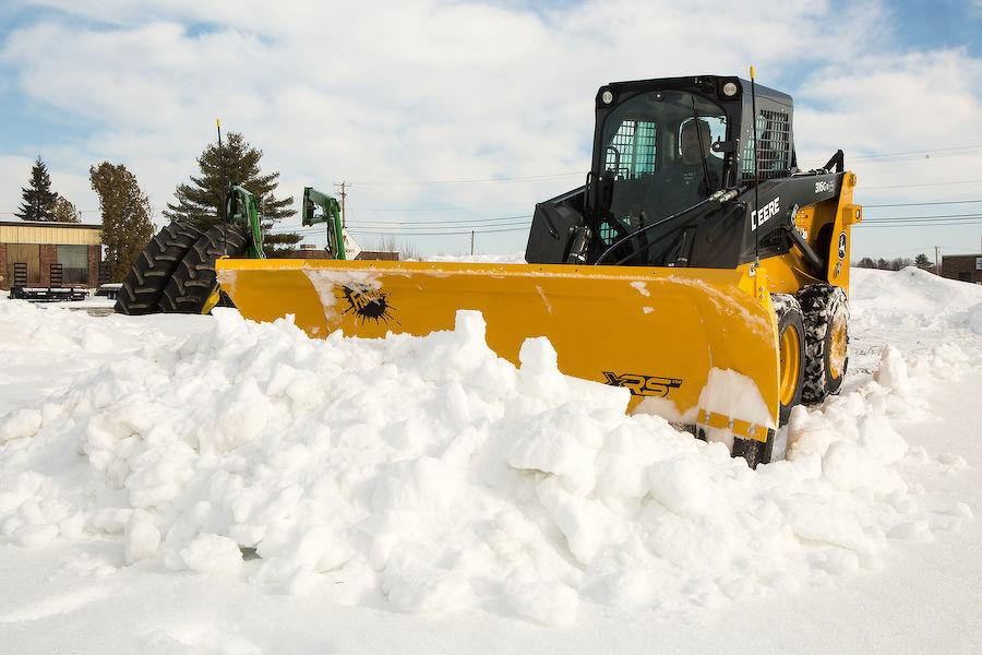 "The XRS plow, designed specifically for skid-steer applications, is a rugged wing plow that automatically puts itself in the ""windrow"" position (scoops the leading wing and retracts the inside wing) when fully angled and then returns to the scoop position once straight."