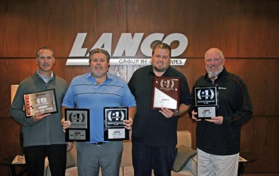 The award was presented to (L-R): Jack Wepfer, VP finance of Lanco; Brian Lynch, general manager of Walter Payton Power Equipment and Mi-Jack Canada; Patrick Lanigan, director of Lanco; and David Hull, general manager of North America, Manitowoc.