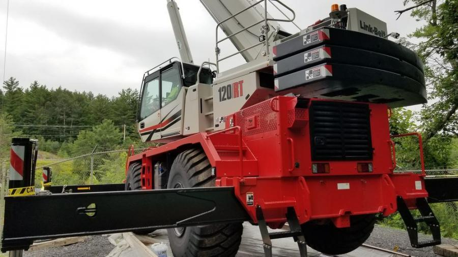 """The PC Construction crane operator was pleased with the crane and said that he encountered no problem getting it onto the site. He also liked the """"SmartFly"""" feature that allows boom pins on the jib to be screwed in with an impact wrench and not from a ladder with a hammer."""