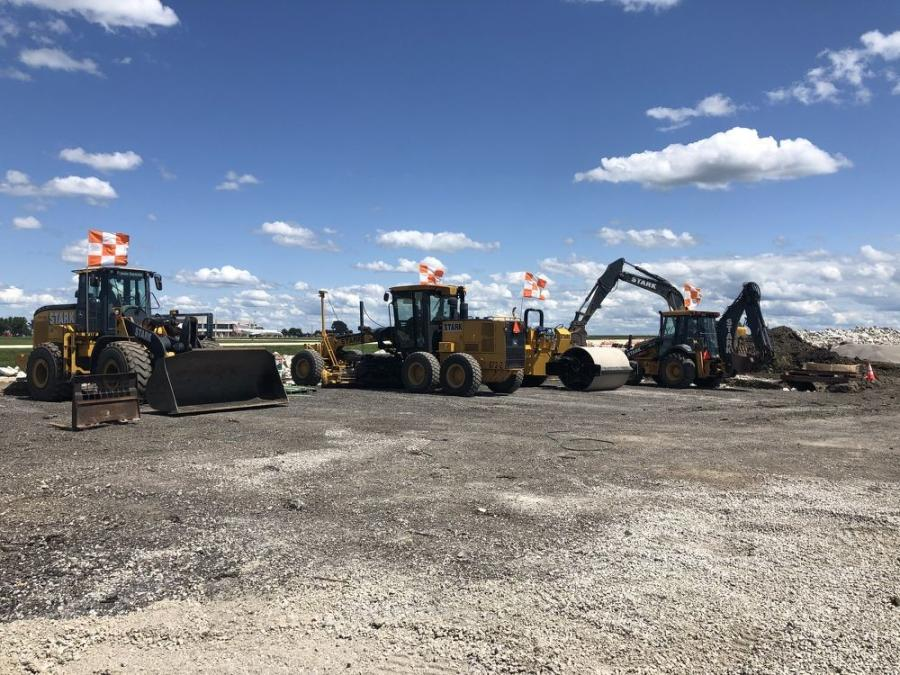 Equipment on site includes track excavators, wheel loaders and bulldozers, along with a host of survey equipment.