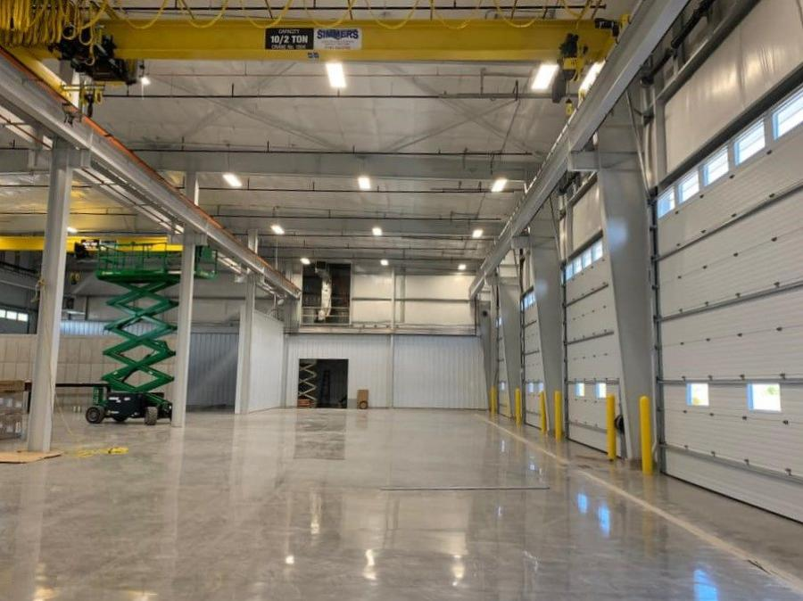 Situated on eight acres, the building includes a parts warehouse with garage door access for receiving and parts dispatch, an eight bay service area equipped with four 10-ton overhead cranes and a separate wash bay.