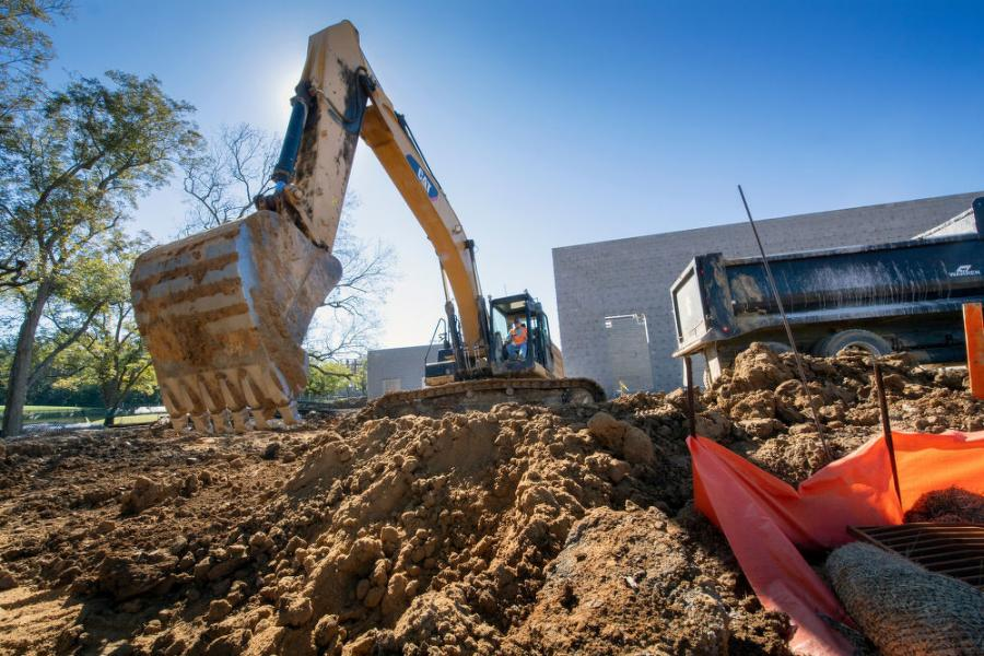 The equipment is being used to excavate for foundation, utilities and additional parking. It's also being used to fill and compact various materials for all site improvements.