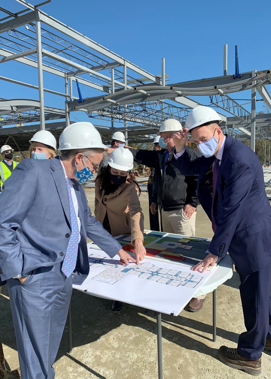 (L-R) are Appoquinimink School Board President Richard Forsten, fellow board member Michelle Wall and Superintendent Matt Burrows discussing plans for the new Brick Mill Early Childhood Center at a beam-topping in early November. The facility opens in fall 2021.
