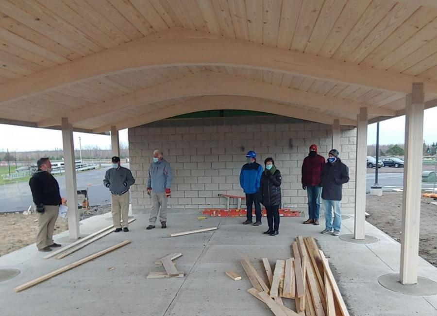 Representatives from the towns of Massena and Louisville and village of Massena toured the progress of work at the Massena Intake Boat Launch and Park. One of the buildings under construction is a small picnic pavilion.