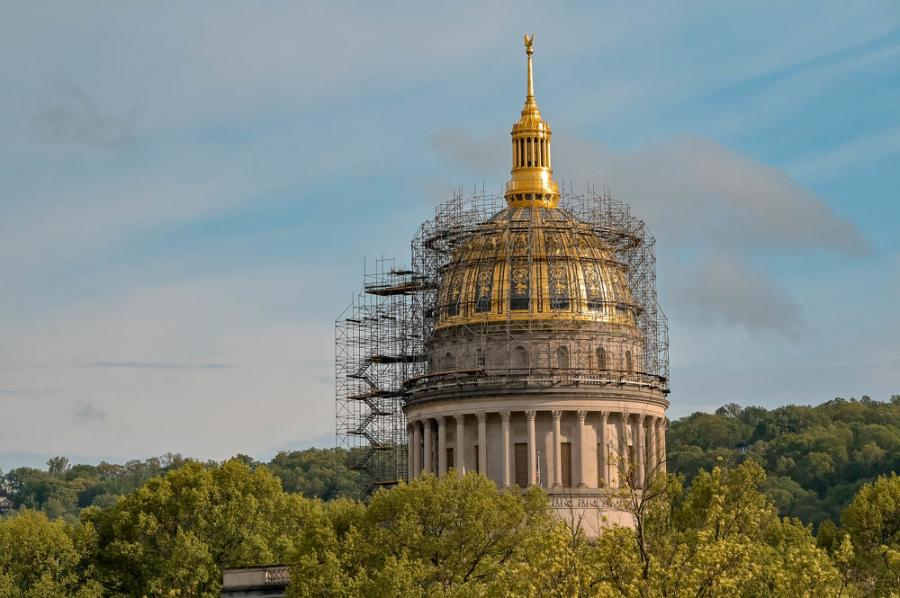 The iconic 292-ft.-tall dome has been hidden under scaffolding and wrapped in plastic.