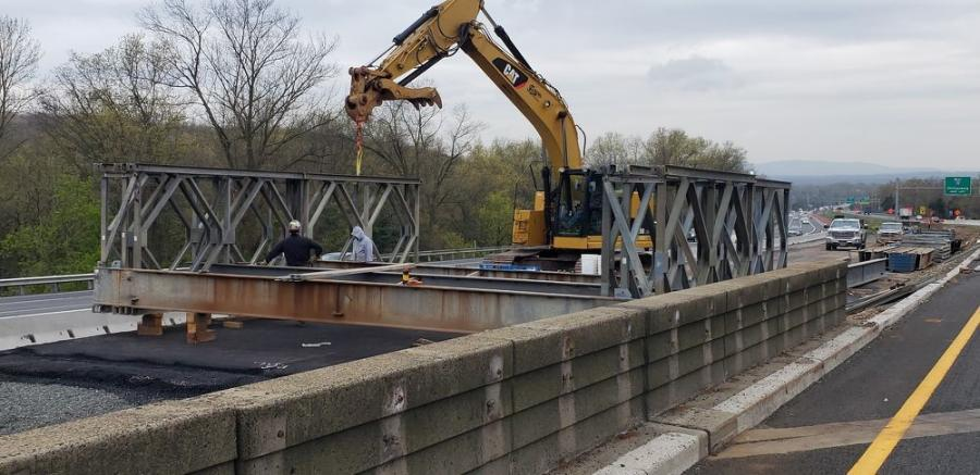 Crews build the temporary roadway in the I-78 median.