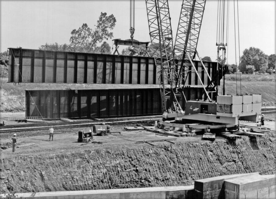 A big crane, and a big girder! A Manitowoc 4100W Ringer picks girders for a railroad bridge over Interstate 480 in Brooklyn Heights, a suburb of Cleveland, Ohio. Allied Bridge is the contractor. This is an early example of the Ringer; introduced in 1968, its major components were a circular track upon which the boom and counterweight traveled, greatly enhancing the crane's lifting capacity in close quarters.