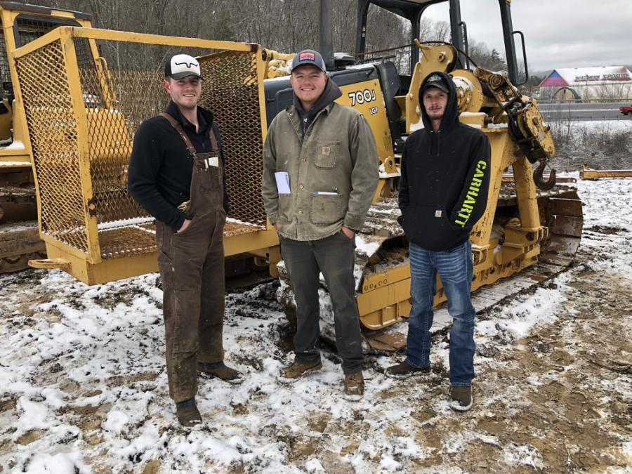 (L-R): The John Deere 700J LGP pipelayer caught the attention of  Jarred and Justin Hook, and Matthew Reynolds, all of McLintock Construction in Jamestown, Tenn.