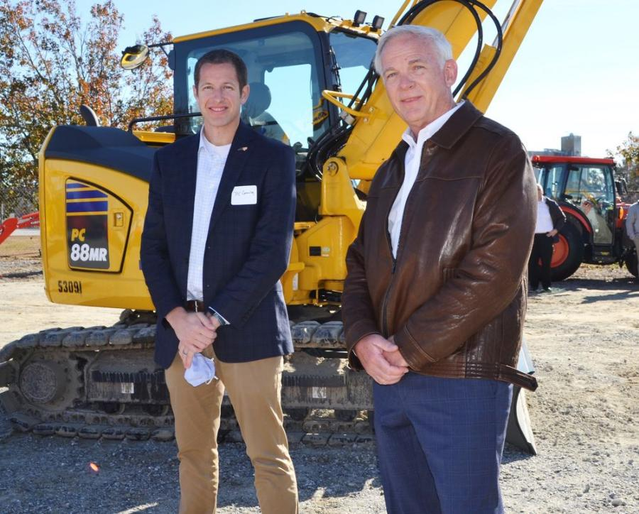 Greenville, North Carolina Mayor P.J. Connelly (L) and Linder President-CEO John Coughlin look over the machines on the equipment yard.