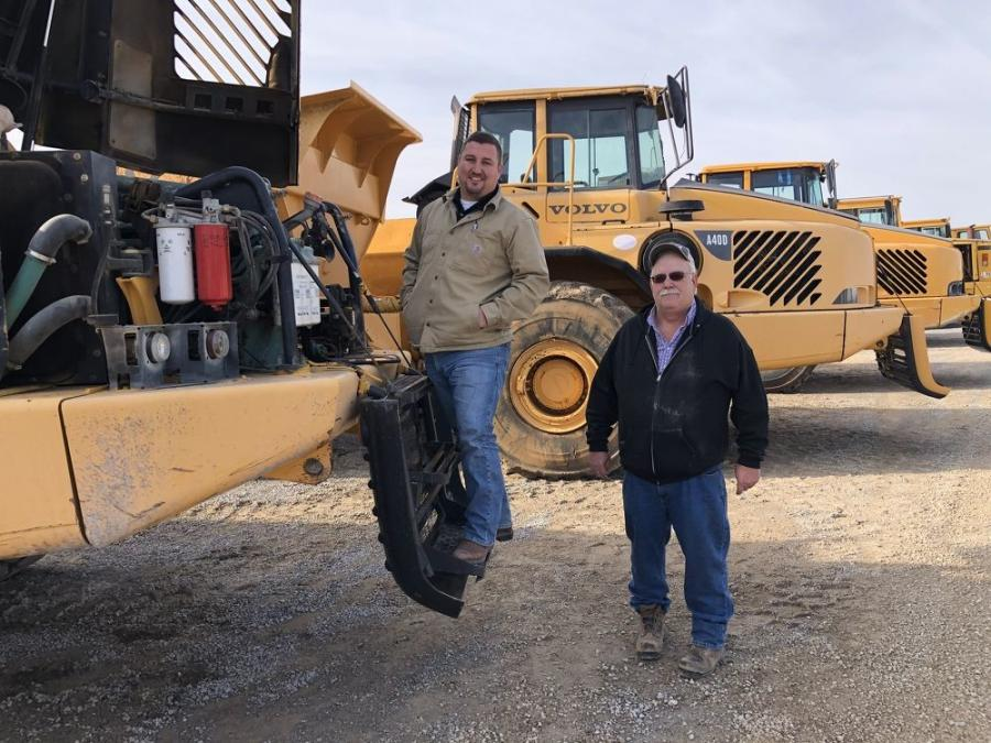 Josh Wright (L) and Tim Overbay, both of Kemper Construction, Carrolton, Ky., inspect the engines on the Volvo 40-ton artic trucks.
