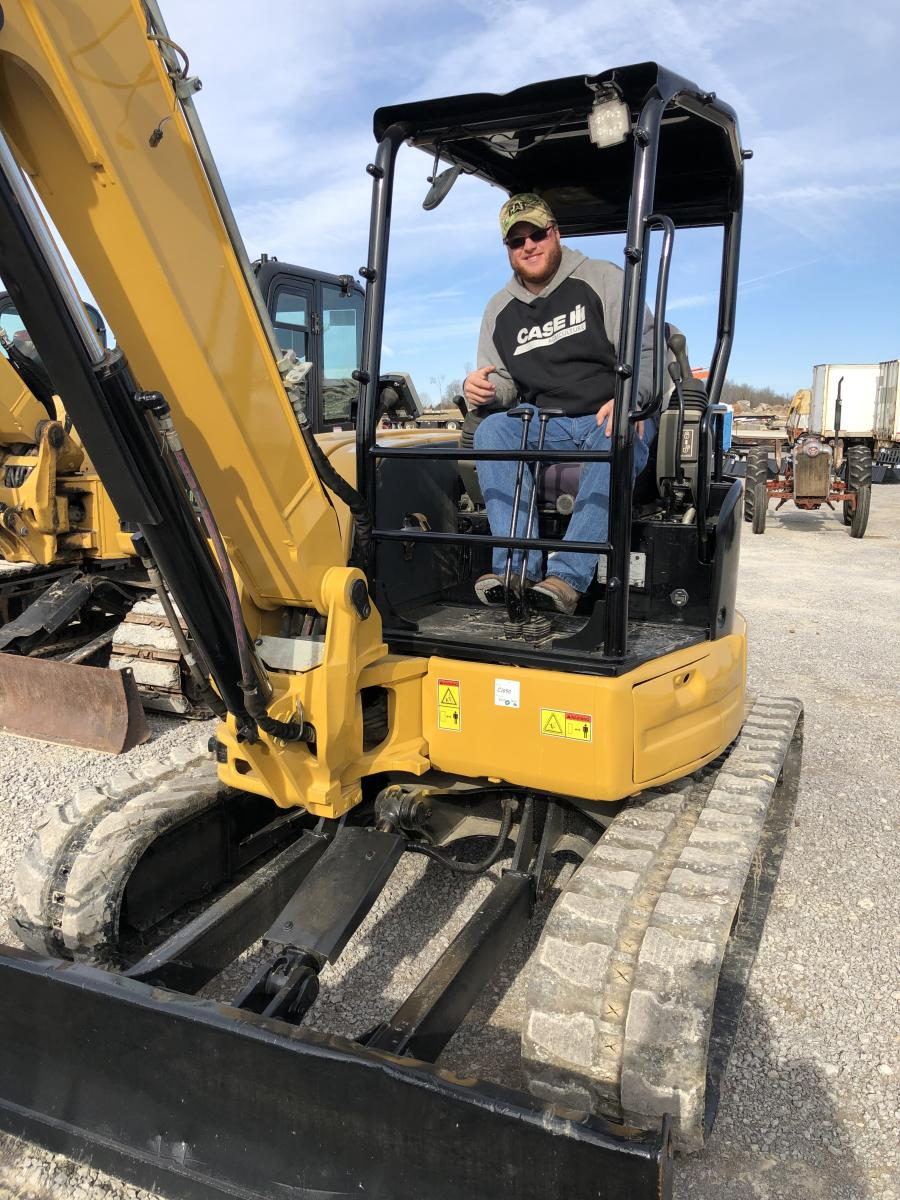 Coty Vannoy of Vannoy Construction in Lebanon, Tenn., was moving some dirt and checking out this Cat 305.5 excavator.