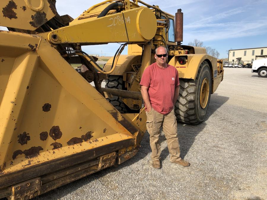 Terry Rainwaters of Rainwaters Farms in Camden, Tenn., came to the auction to bid on this John Deere 860A scraper.