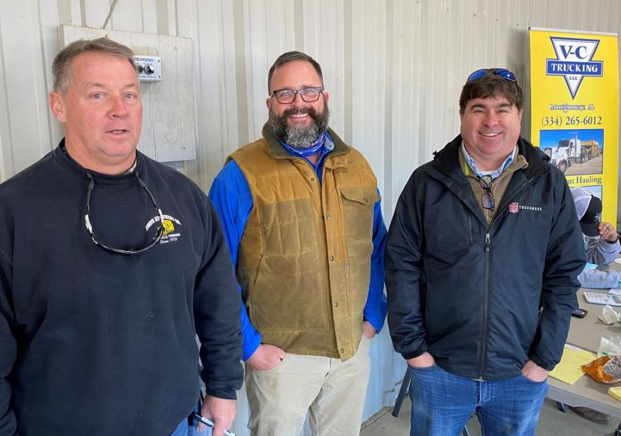 (L-R): Bill Woods, Woods Equipment, Nashville, Tenn; George Massey, JM Wood Auction; and Stan Maxey, VC Trucking, Montgomery, Ala., watch and discuss the machines and trucks being auctioned.