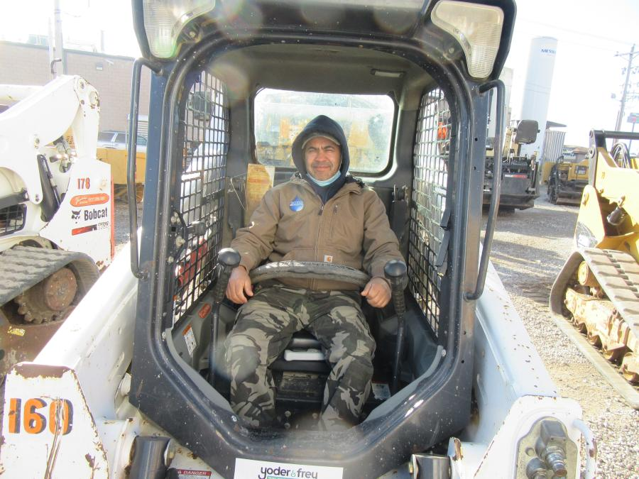 Paco Soto of Soto Irrigation considers a bid on this Bobcat T590 skid steer at Yoder & Frey's North Baltimore, Ohio, auction.