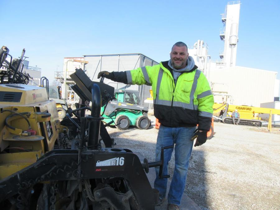 Tony Siferd of Helms & Sons Excavating looks over the Mauldin 1750c asphalt paver at the North Baltimore, Ohio, auction.