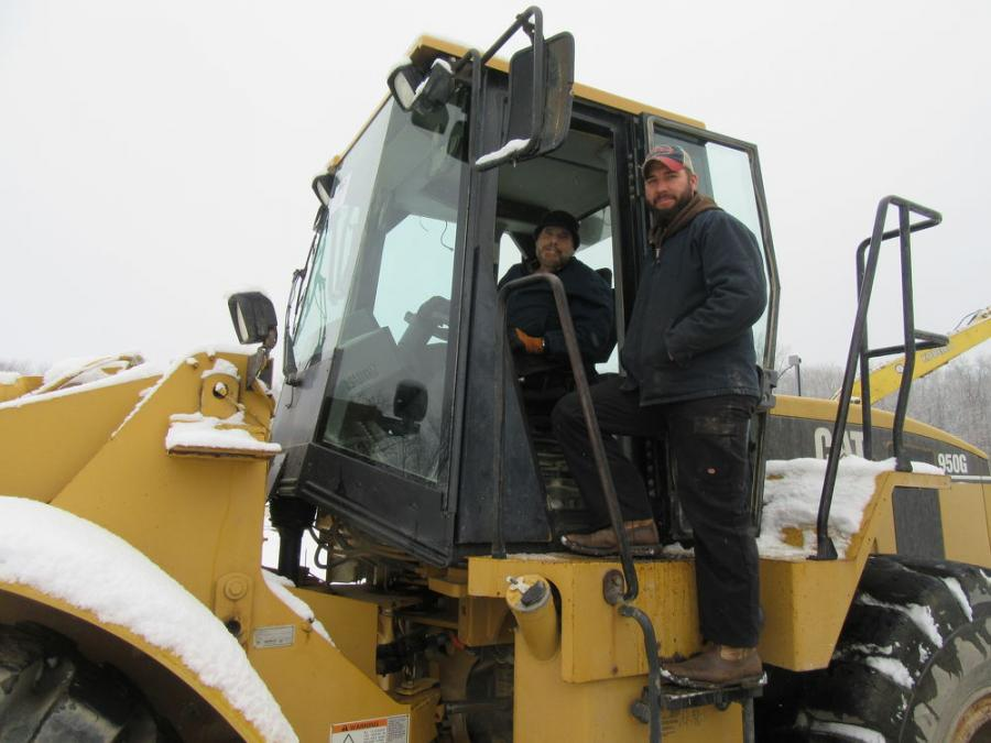 Drew and Robert DeVier of DeVier Excavating reviewed the wheel  loaders at Yoder &  Frey's Mark Haynes Construction  auction.