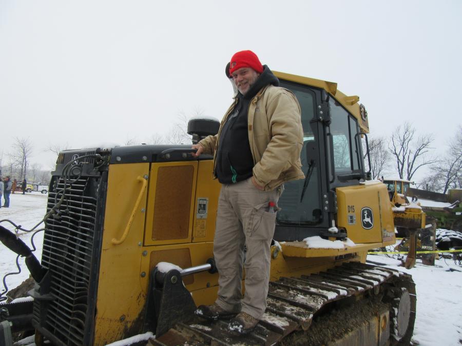 Bob Miller of Wakeman, Ohio, looked over this John Deere 750K dozer he was interested in bidding on.