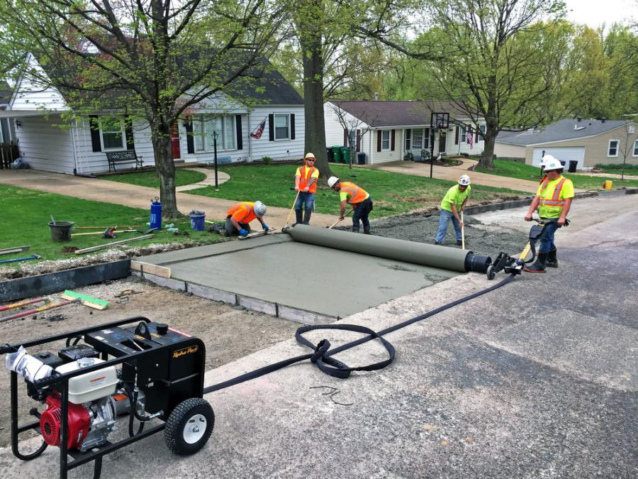 A concrete crew in St. Louis, Mo., pairs Curb Roller Manufacturing's 14-ft. custom drum and Hydra-Screed to pour street and curbing in the same pass; meeting the need for more linear feet in less time.