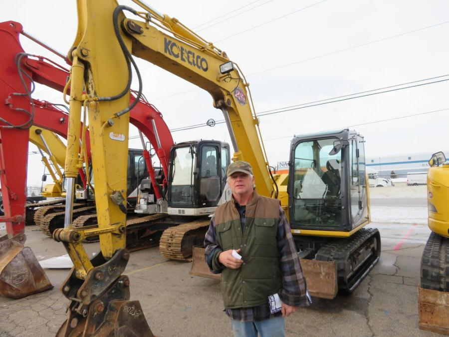 Looking over some of the Kobelco excavators is Randy Rolefson of Rolefson Excavating.