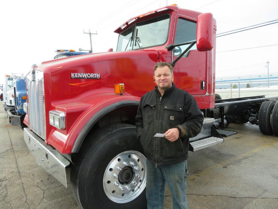 Brian Donahue of DB Construction has a look at this Kenworth truck.