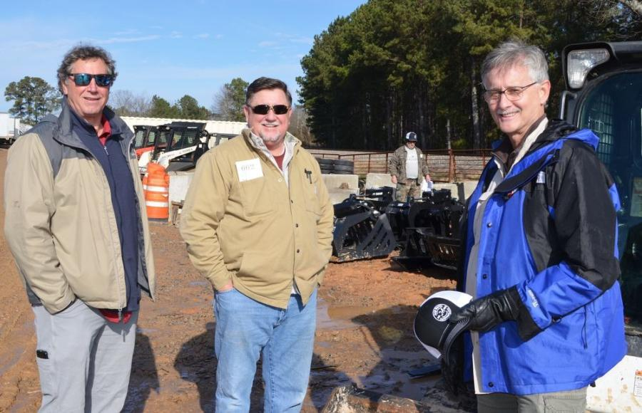 (L-R): Bill McBrayer, Specialty Tree Service, Acworth, Ga.; Lee Cole, Lee Cole Renovations, Carrollton, Ga.; and Mike Lanier, Arkenstone, Acworth, Ga., discuss their preferences of machines to bid on.