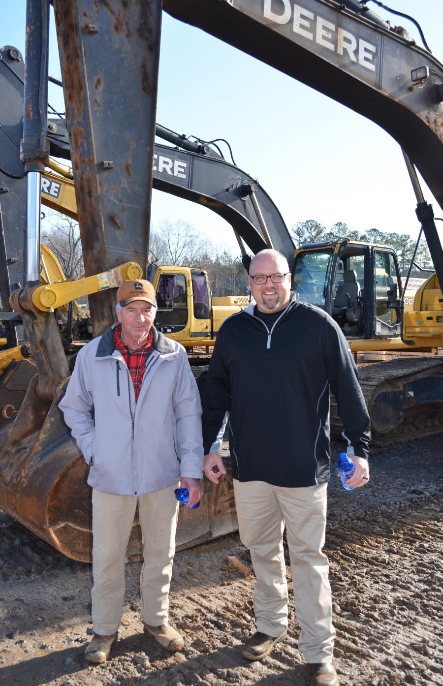 Looking over a pair of Deere excavators in the sale are Scott Bowden (L) of Crawford Grading & Pipeline, Luthersville, Ga., and Jason Solesbee of the local Georgia John Deere dealership, Flint Equipment Company.