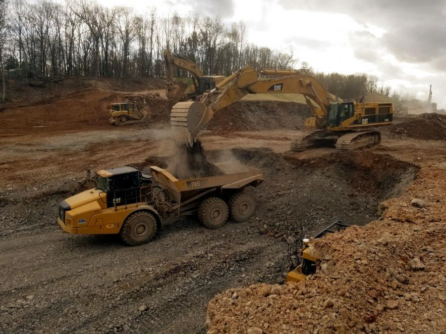 Equipment being used on the job includes D9, D10 and D11 Caterpillar dozers; 745C and 775F Caterpillar haul trucks; a 651E Caterpillar earth mover/scraper; 825C Caterpillar compactors; and 349E Caterpillar excavators.