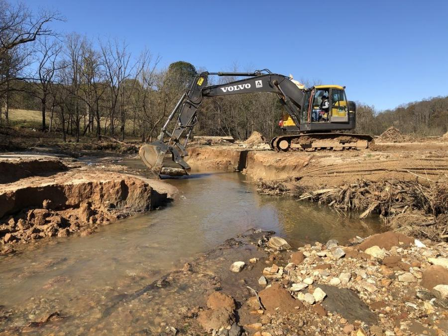 Before starting the work in the mountains, Riley Lecka and Wildlands made sure they had the right construction equipment for the project, like this Volvo ECR235E excavator.
