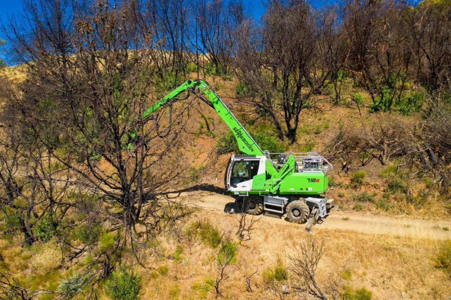 Removing burned out trees from wooded areas is an ideal job for Atlas' 718.