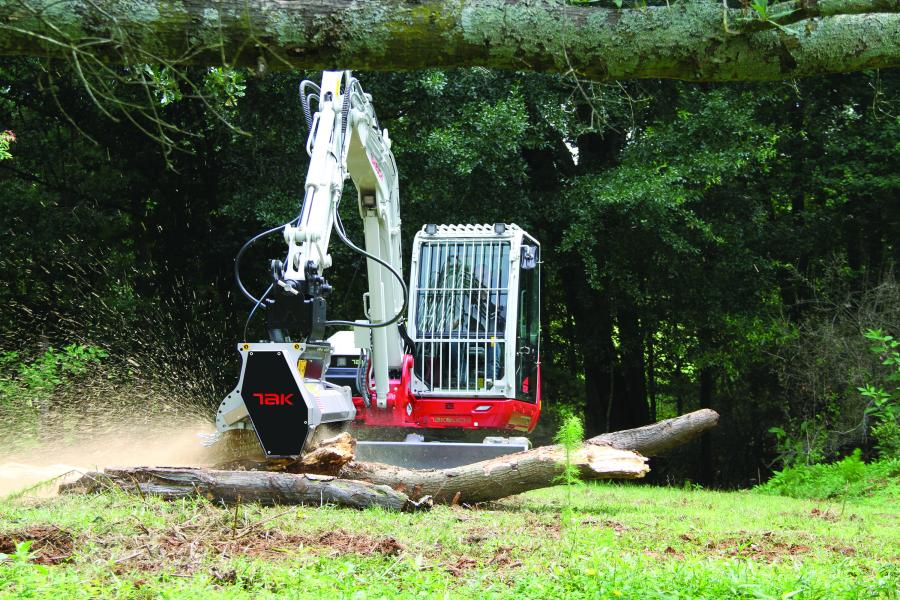 A Takeuchi TB370 compact excavator uses the new Takeuchi mulching head attachment.