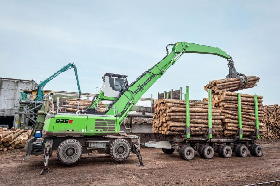 The 835 M-HDS E-Series with trailer feeds the plant, transports and loads logs.