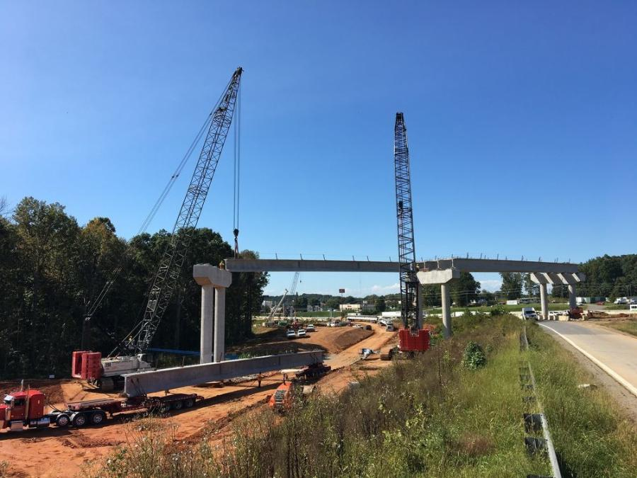 More supports are being constructed for the flyover portion of the partial turbine interchange supports for I-40 WB to I-77 SB. (Lane Construction photo)