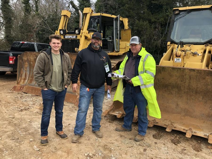 (L-R): Jake Wilder, Brian Rhodes and Jimmy Rhodes, all of Rhodes Grading in Woodruff, S.C., were hoping to bring the Cat D6T back home with them.