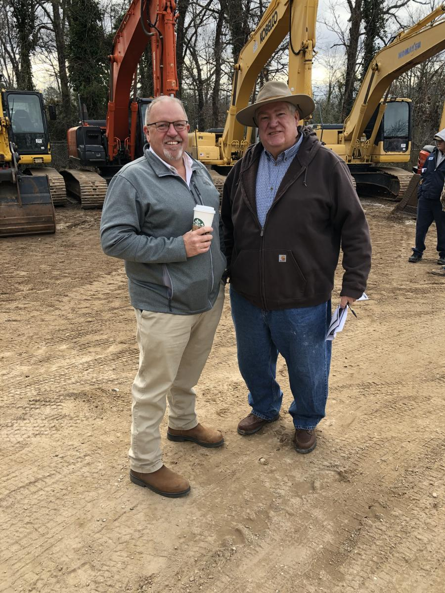 Jeff Martin (L) and Dale Mason, of Mason Equipment in Johnson City, Tenn., took a few minutes to visit before the bidding began.