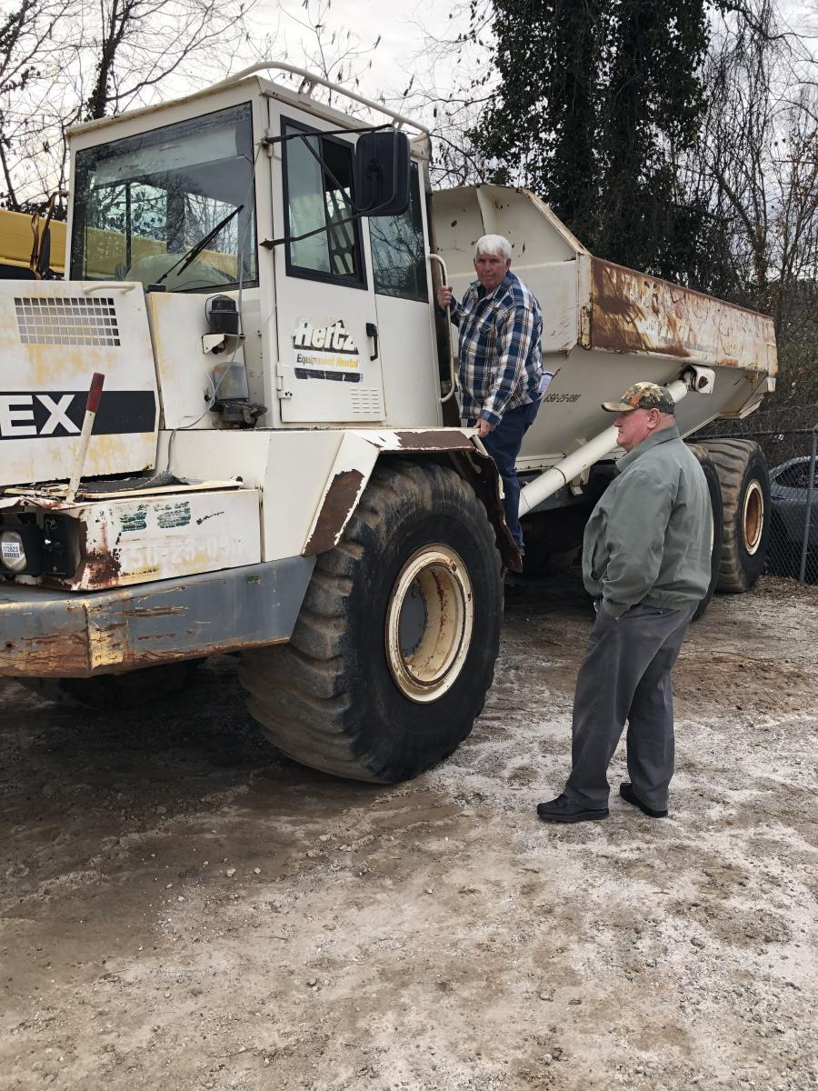 Ronnie Coleman (L) and Billy Joe Wilson, both of 84 Limestone in Monterey, Tenn., looked over the artic trucks. They planned to bid on a few trucks and excavators.